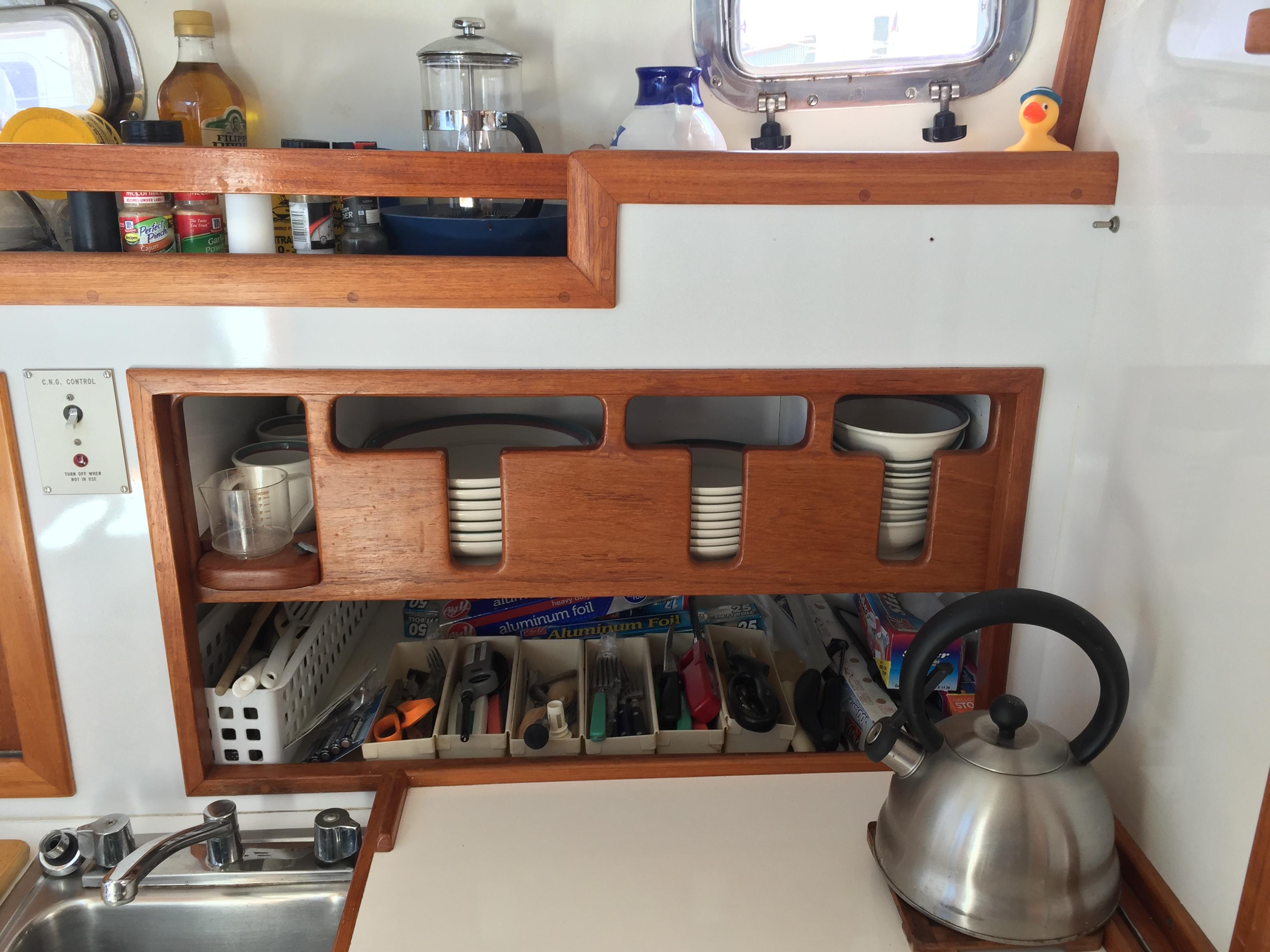 Custom dish storage in galley Wilbur Yachts